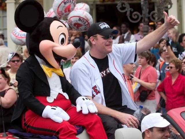 Schilling waves at fans during a parade at Walt Disney World October 28, 2004. Hundreds of fans turned out to support the World Series champion.