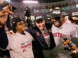 Pedro Ramirez, Curt Schilling and David Ortiz celebrate the 2004 World Series win against the St. Louis Cardinals.
