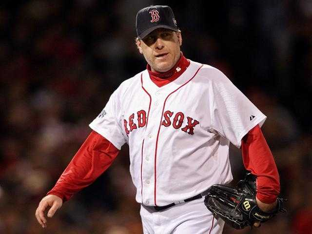 Schilling comes out of the game in the sixth inning against the Colorado Rockies during Game Two of the 2007 World Series at Fenway Park on October 25, 2007