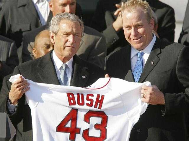 President Bush holds a Red Sox team jersey presented by Schilling with the 2004 World Series Champion Boston Red Sox on the South Lawn of the White House.