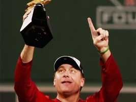 Schilling celebrates after his team defeated the Cleveland Indians in the American League Championship Series at Fenway Park on October 21, 2007