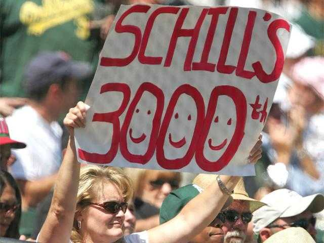 A fan holds a sign for Schilling after his 3000th career strike out Aug. 30, 2006.