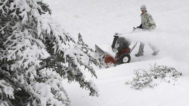 Snow AP PHOTO Man With Snowblower - 18833562