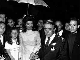 Aristotle Onassis and his new wife, Jacqueline Kennedy with her daughter Caroline, walk back to his Yacht after their wedding on Scorpios Island, Greece on Oct. 20, 1968