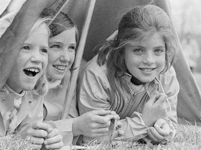 Caroline, right, Courtney, center, and Carrie Kennedy are seen in a pup tent at a campsite, May 9, 1967. Courtney and Carrie are Robert Kennedy's children.
