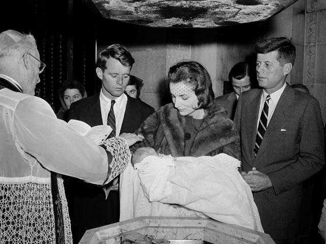 15-day-old Caroline Kennedy is christened by Boston's Archbishop Richard Cushing in St. Patrick's Cathedral in New York, Dec. 13, 1957.