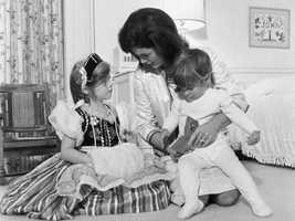 Jacqueline Kennedy reads a storybook to her children at the White House in August 1962.