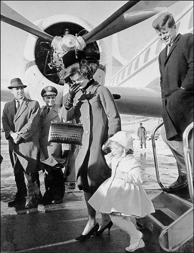 This undated picture shows John Kennedy, Jacqueline and Caroline arriving at an airport.