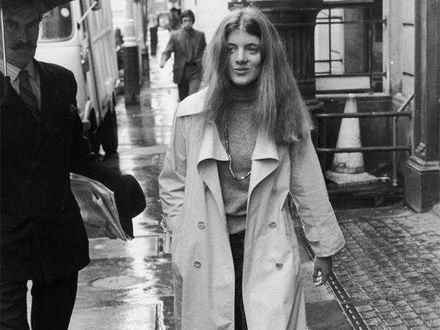 Caroline Kennedy walking on a rain-soaked street after house-hunting with her mother in London in 1975.