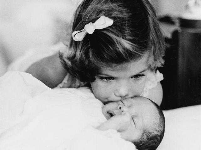 Caroline Kennedy kisses her little brother John Jr.