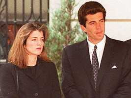 Caroline Kennedy Schlossberg and her brother watch as the casket containing the body of their mother is placed in a hearse on May 23, 1994.