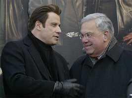 "Actor John Travolta talks with Menino during an event for Travolta's new movie, ""Wild Hogs,"" in Boston, Feb. 7, 2007"