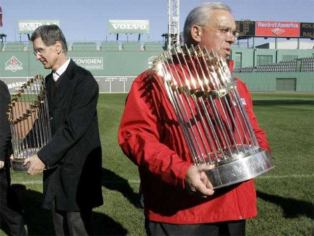 Menino holds the World Series trophy prior to a victory parade at Fenway Park, Oct. 30, 2007. Menino stumbled on stairs shortly before walking onto the field injuring his knee.