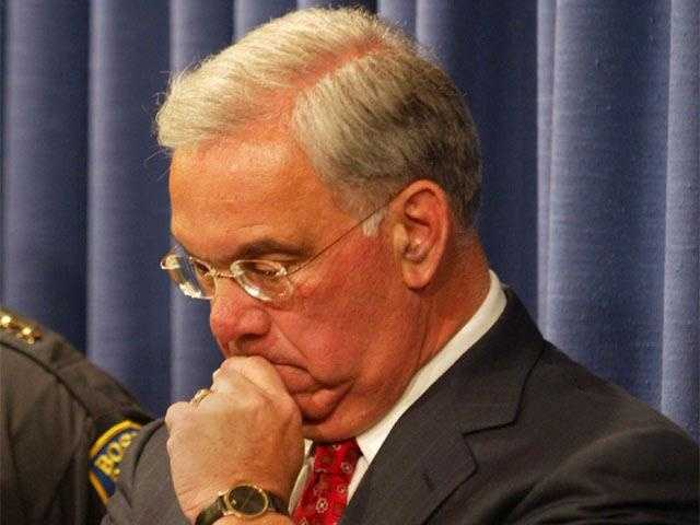 Menino listens during a news conference about the death of Victoria Snelgrove, Oct. 21, 2004. Snelgrove died after a clash between police and a crowd of Red Sox fans.
