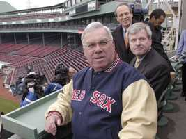 """Menino is given a tour, April 3, 2003, of the new seating area above the """"Green Monster"""" at Fenway Park."""
