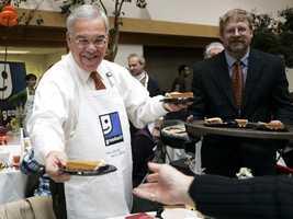 Menino serves pumpkin pie during the Thanksgiving dinner at Goodwill, Nov. 23, 2005.