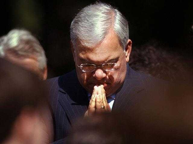 Menino clasps his hands during a group prayer following observance ceremonies in the Boston Public Garden September 11, 2003.