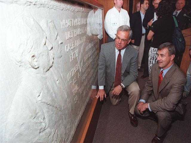 Menino and Gov. Paul Cellucci look at a plaster mold of a sculpture of Nicola Sacco and Bartolomeo Vanzetti after an unveiling ceremony at the Boston Public Library, Aug. 23, 1997.