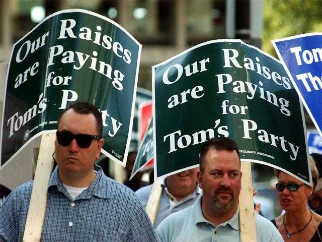 Boston Police Patrolmen's Association carry signs referring to Menino as they walk a picket line outside the Boston Sheraton Hotel, June 28, 2004.