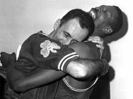 Regarded as one of the greatest basketball players of all time, Bill Russell anchored the Celtics teams that won nine, (eight in succession) NBA world championship titles in 1957 and from 1959 through 1966, and two more in consecutive seasons in 1968 and 1969. Pictured here, Cousy hugging Russell.