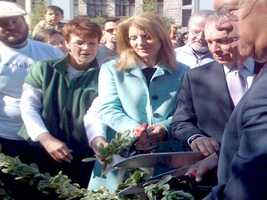 Caroline Kennedy, Boston Mayor Thomas Menino and New York City Mayor Michael Bloomberg take part in a ribbon-cutting ceremony to open Boston's Rose Kennedy Greenway.