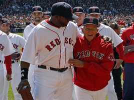 David Ortiz and Johnny Pesky walk to center field to raise the 2007 World Series banner, April 8, 2008.