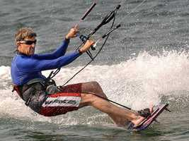 Kerry waves while kite boarding in Nantucket Harbor, July 17, 2004.