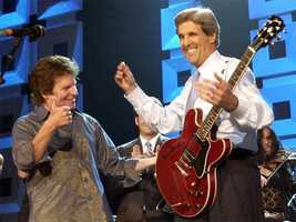 Rocker John Fogerty reacts after Kerry played the guitar during a concert benefiting his campaign at Radio City Music Hall in New York, July 8, 2004.