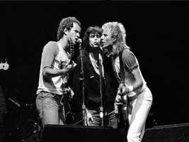 Tennis players John McEnroe, left, and Vitas Gerulaitis, right, join lead singer Steven Tyler of the rock group Aerosmith during a benefit concert, Tennis/Rock '83, for the special Olympics at Pier 84 in New York City, July 24, 1983.