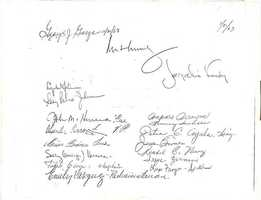Can you identify the signatures from the guest book that night?
