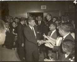 The President had said he would attend, but the organizers were still surprised and relieved when Jacqueline & John Kennedy walked through the doors.