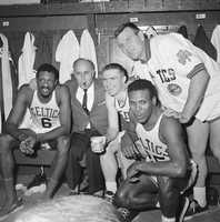 Center with Bill Russell, Red Auerbach, Jim Locustoff and K.C. Jones after winning the Eastern division in 1964.