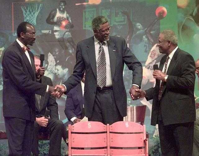Russell is honored by his former teammates Satch Sanders, left, and K.C. Jones, right, as he is presented with two chairs from the Boston Garden during a tribute May 26, 1999.