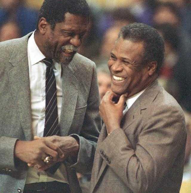 Former teammates Bill Russell, Sacramento Kings coach, and K.C. Jones, Celtics coach, meet before the start of the game Jan. 15, 1988.