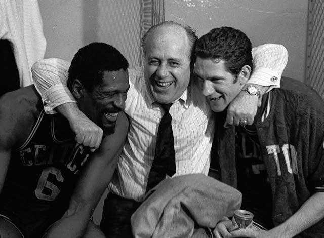 Red Auerbach hugs the stars of the Celtics NBA Championship win over the Los Angeles Lakers, Bill Russell and John Havlicek, May 3, 1968.