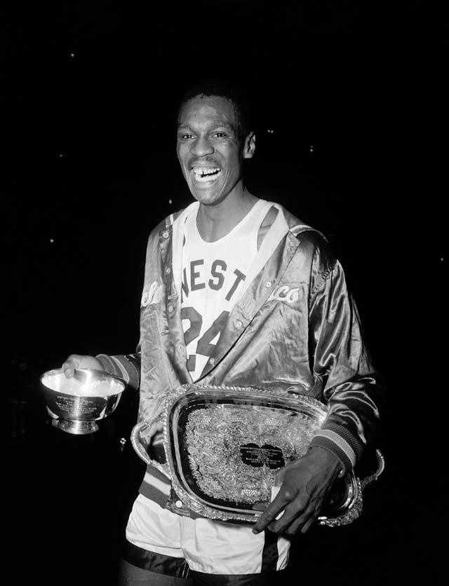 Russell holds his Most Valuable Player trophies at Madison Square Garden in New York, March 31, 1956.