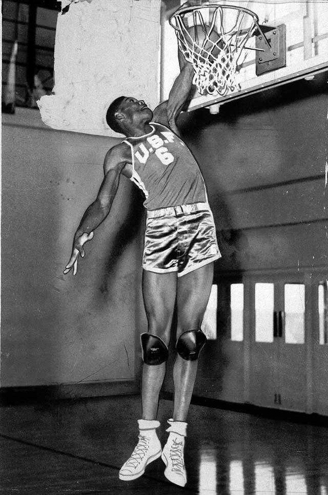 Bill Russell is in fine form as he dunks the ball with ease, Jan. 31, 1955. The 6-foot, 10-inch center played for the University of San Francisco.