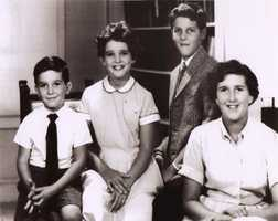 Kerry is seen in this undated photo with his siblings, from left, Cam, Diana, and, right, Peggy.