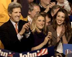 Kerry accompanied by his daughters Vanessa and Alex applaud with the crowd at a victory party Jan. 19, 2004, in Des Moines after Kerry was declared the winner of the Iowa Caucus.