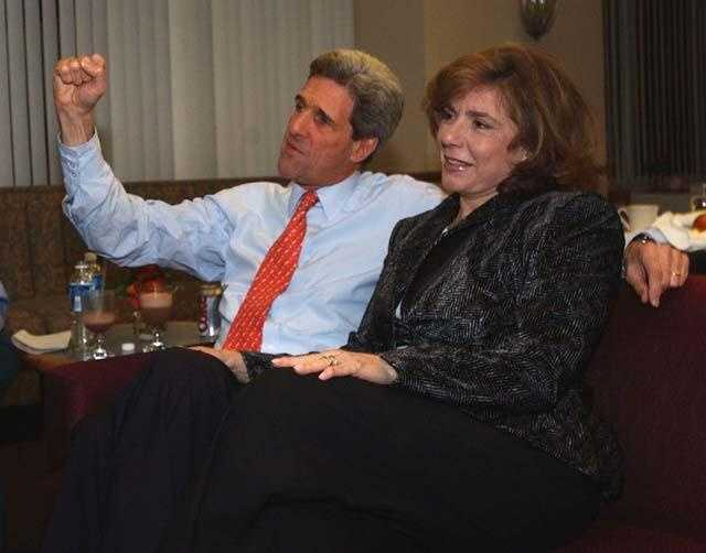 Kerry pumps his fist while watching Virginia primary returns with his wife Teresa at George Mason University in Fairfax, Va., Feb. 10, 2004.