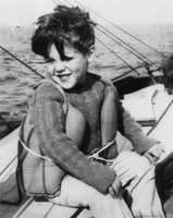 Kerry is seen in this family photo at the age of 6, boating in Massachusetts.