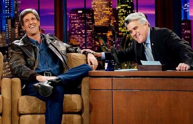 Wearing a leather jacket over a denim shirt and pants that he wore while making his entrance driving a motorcycle onstage on the Tonight Show with Jay Leno, Nov. 11, 2003.