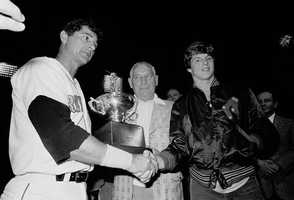 Yastrzemski is joined by his father Carl and his son Mike after he belted his 3,000th career hit at Fenway Sept. 12,1979