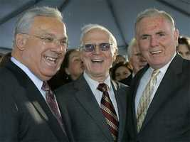 Former Mayor Kevin White laughs with current Mayor Thomas Menino and Ray Flynn prior to the unveiling of a statue bearing White's likeness outside Faneuil Hall Nov. 1, 2006.