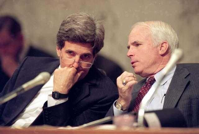 Kerry, chairman of the Senate Select Committee on POW/MIA Affairs, listens to Sen. John McCain, during a hearing Dec. 1, 1992.