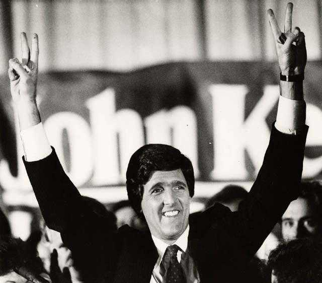 Senator-elect John Kerry raises his arms in victory in this Nov. 6, 1984 photo in a Boston hotel where he celebrated his defeat over Ray Shamie, a Republican businessman.