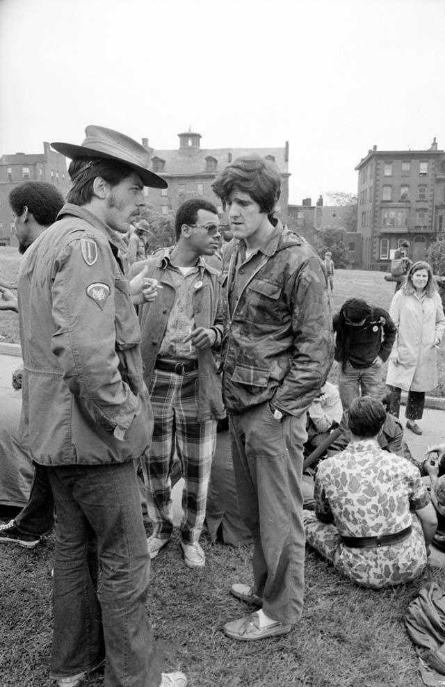 John Kerry talks with other Vietnam veterans against the war at the foot of Bunker Hill monument prior to a march to Boston Common May 31, 1971.