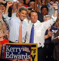 Kerry and his running mate, Sen. John Edwards wave to the crowd during a campaign speech in St. Petersburg, Fla. July 7, 2004.