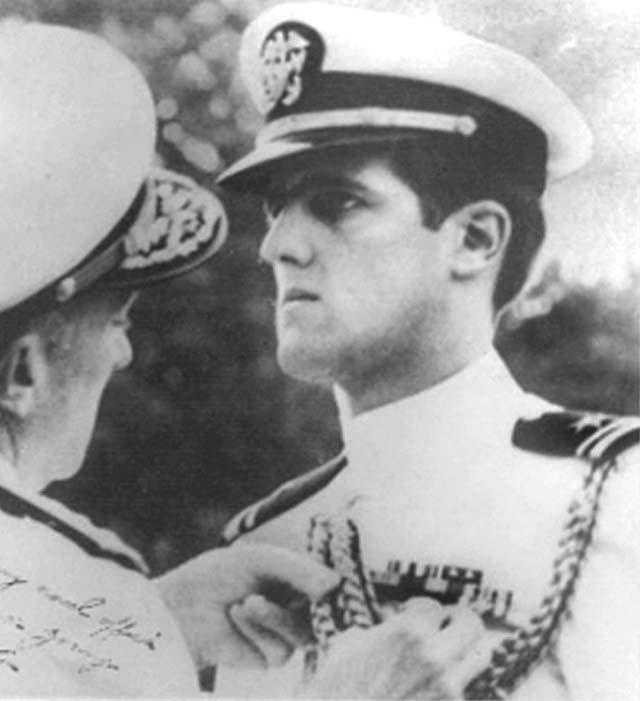 Kerry seen in this 1960s photo receives a military decoration during the Vietnam War.