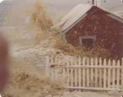 Wave smashing into cottage by boathole on the Gurnet